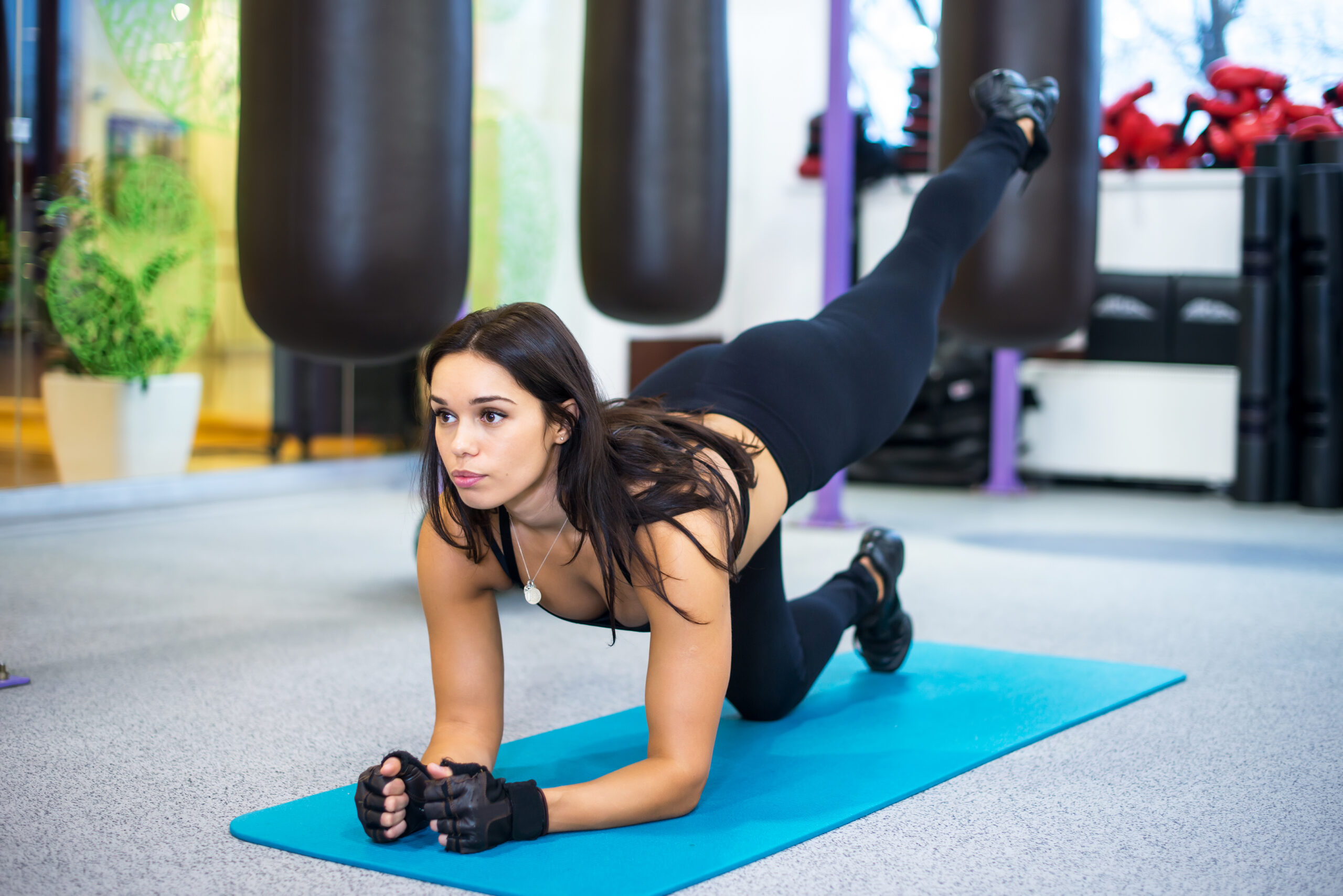 athletic sporty slim woman doing yoga exercise in the gym